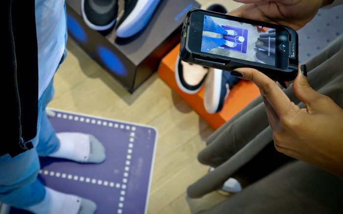 Nike officials demonstrate the company's foot-scanning tool on its app that will measure and remember the length, width and other dimensions of customers' feet after they point a smartphone camera to their toes in New York. Nike Inc. reports earnings on Thursday, June 27Earns Nike, New York, USA - 24 Apr 2019
