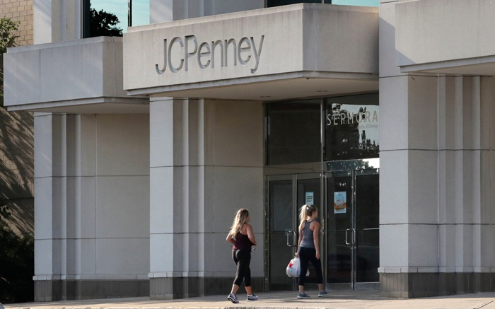 Two women walk into the JCPenney store in Peabody, Mass. J.C. Penney Co. on Thursday, Aug. 15, reported a loss of $48 million in its fiscal second quarterEARNS JC Penney, Peabody, USA - 14 Aug 2019