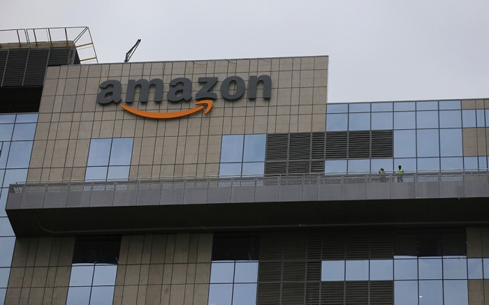 Indian workers stand on a balcony of Amazon's newly inaugurated campus building in Hyderabad, India, . Built to support more than 15,000 employees, the new campus is Amazon's first owned office building outside the US and the single largest building globally, according to an Amazon press releaseAmazon, Hyderabad, India - 21 Aug 2019