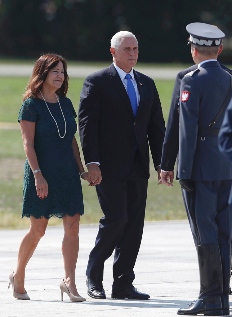 Karen pence, lace dress, stilettos, celebrity style, U.S. Vice President Mike Pence holds hands with his wife Karen as they arrive for a memorial ceremony marking the 80th anniversary of the start of World War II in Warsaw, PolandWWII Anniversary, Poland, Poland - 01 Sep 2019