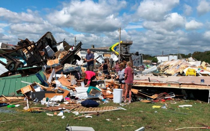 Friends and neighbors sift through what is left of a damaged trailer at the Boardwalk RV Park in Emerald Isle, N.C., on . A tornado from an outer band of Hurricane Dorian damaged about a dozen RVs nearly a day before Dorians eye passed just offshore of the islandTropical Weather, Emerald Isle, USA - 06 Sep 2019