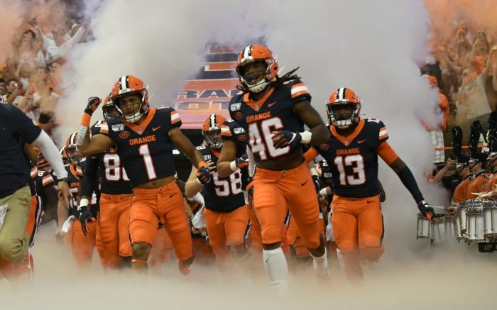 Syracuse team enters the Carrier Dome during the NCAA college football game, in Syracuse, N.YFootball, Syracuse, USA - 14 Sep 2019