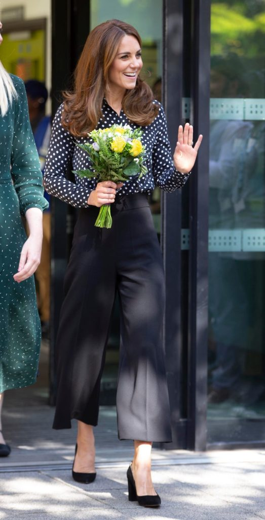Kate middleton, flowers, equipment shirt, polka dot blouse, wide legged trousers, pointy toe pumps, Catherine Duchess of CambridgeCatherine Duchess of Cambridge visits Sunshine House Children and Young People's Health and Development Centre, Peckham, London, UK - 19 Sep 2019To further her research and engagement with the Early Years sector, Catherine Duchess of Cambridge will visit Sunshine House Children and Young People's Health and Development Centre to meet with the Southwark Family Nurse Partnership team and highlight the valuable work that they do. Wearing Equipment, Shirt