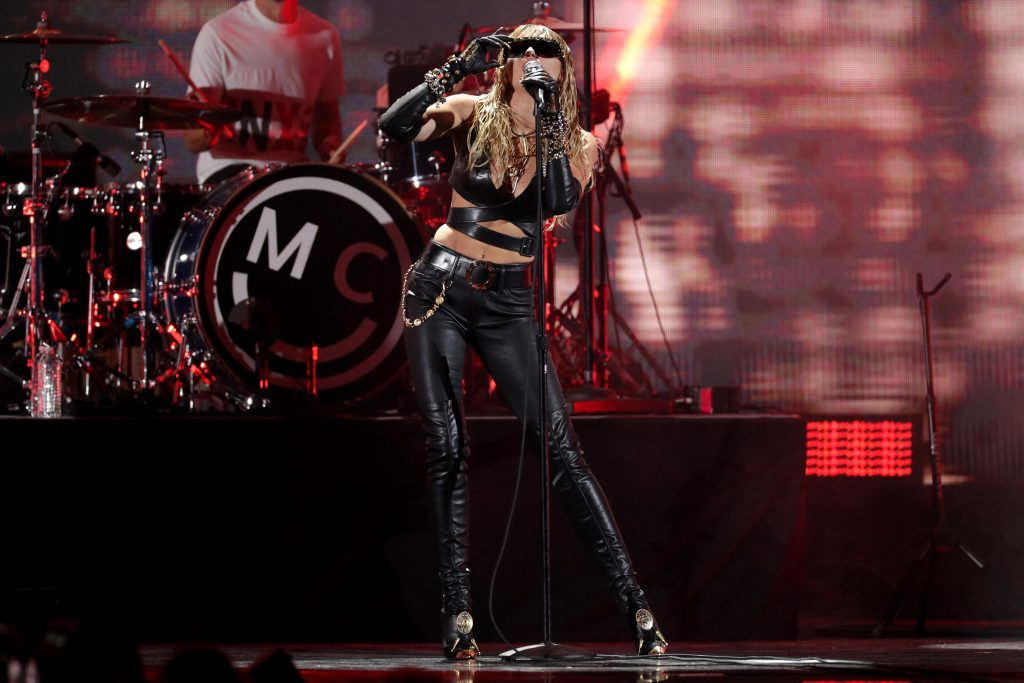 Miley Cyrus, bra top, gloves, sunglasses, thigh boot boots, leather pants, abs, celebrity style, iHeartRadio Music Festival, Day 2, Show, Las Vegas, USA - 21 Sep 2019