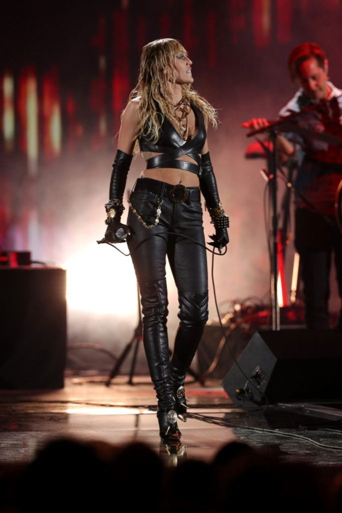 Miley Cyrus, crop top, bra top, abs, gloves, leather pants, thigh high boots, blond hair, iHeartRadio Music Festival, Day 2, Show, Las Vegas, USA - 21 Sep 2019