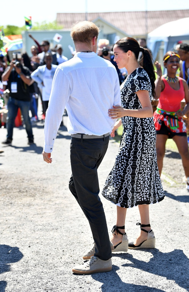 meghan markle, printed black and white dress, castaner shoes, espadrille wedges, royal style, Prince Harry and Meghan Duchess of Sussex at the Justice Desk initiative in Nyanga township, Cape Town, South AfricaPrince Harry and Meghan Duchess of Sussex visit to Africa - 23 Sep 2019