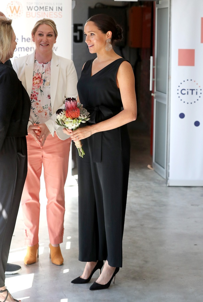Meghan markle, Manolo blahnik bb, classic black pumps, stilettos, everlane, jumpsuit, Duchess of Sussex,visits Woodstock Exchange, a women founders/social entrepreneurs event with Prince Harry, Duke of Sussex in Cape Town, South Africa, 25 September 2019. The Duke and Duchess of Sussex are on an official visit to South Africa. Woodstock Exchange, the UK-SA Tech Hub focuses on skills development and access to markets by assisting entrepreneurs, particularly women, to acquire skills, resources and support.Duke and Duchess of Sussex on royal tour of South Africa, Cape Town - 25 Sep 2019