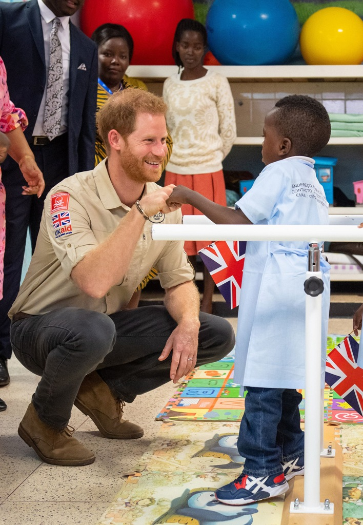 Prince Harry, chukka boots, celebrity style, meets Barnaby Jose Mar, 6, as he visits the Princess Diana Orthopaedic Centre in Huambo, Angola 27 September 2019. His Royal Highness will visit to see the work of landmine clearance charity the Halo Trust. The Duke and Meghan Duchess of Sussex are on an official visit to South Africa.Duke and Duchess of Sussex Royal tour of Angola, Dirico - 27 Sep 2019