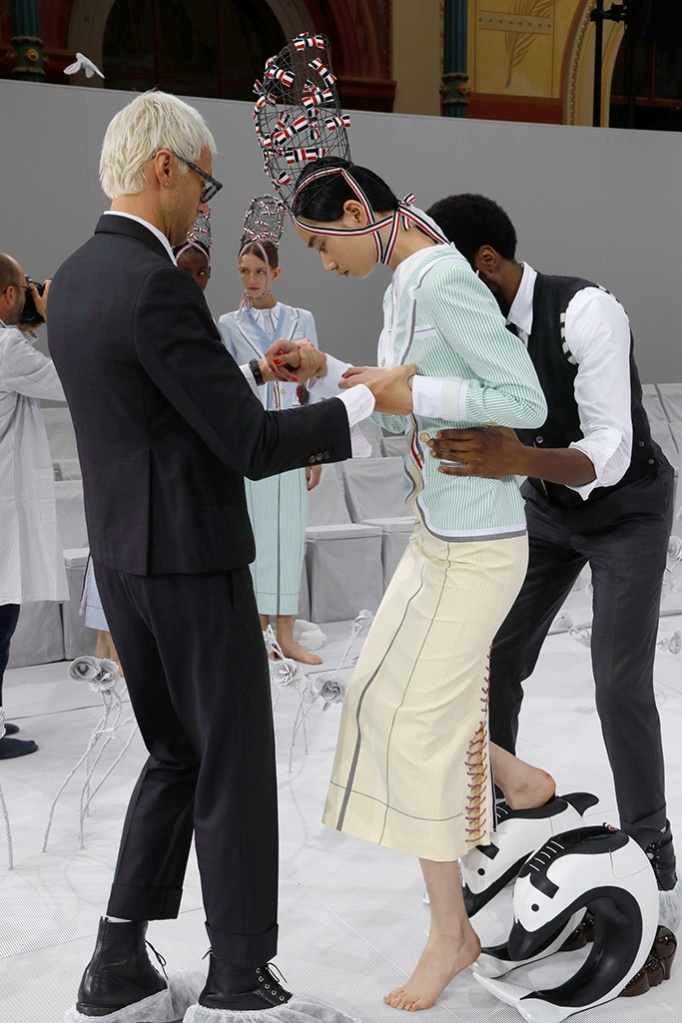 A model prepares for the Thom Brown spring '20 show, ss2020, pfw, dolphin shoes