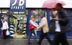 Pedestrians pass a JD Sports store