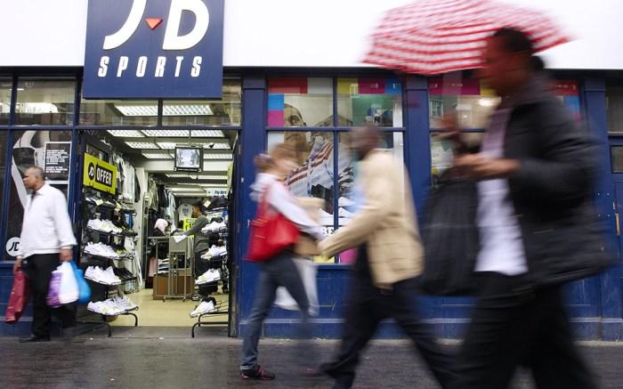 Pedestrians pass a JD Sports store at WhitechapelVarious City AM - 2008