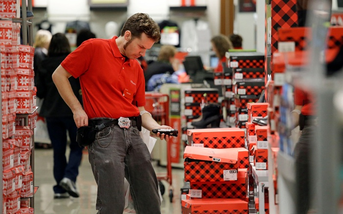 A JCPenney store employee checks inventory during Black Friday sales, in Seattle. Black Friday has morphed from a single day when people got up early to score doorbusters into a whole season of deals, so shoppers may feel less need to be outHoliday Shopping Black Friday, Seattle, USA - 24 Nov 2017