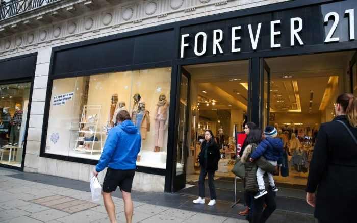 Shoppers pass by a Forever 21 store in London