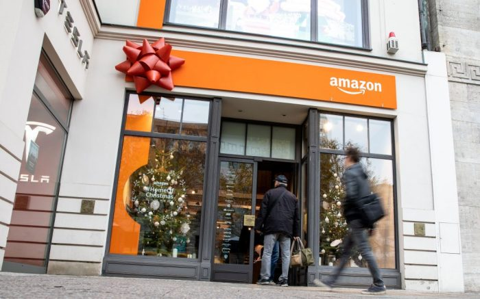 People enter an Amazon pop-up store at the central Mitte district's shopping avenue of Kurfuerstendamm, in Berlin, Germany, 22 November 2018. The online shopping giant opens a six days pop-up store in the heart of the German capital, offering a variety of Christmas gifts, 'Home of Christmas' will be open to the public from 22 to 27 November 2018.Amazon opens a Christmas pop-up store in Berlin, Germany - 22 Nov 2018