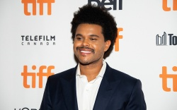 The Weeknd, attends a premiere for