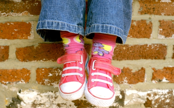 young girl wearing pink sneakers