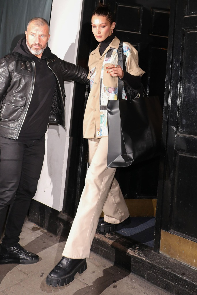 Bella Hadid, prada shoes, combat boots, celebrity style, street style, khaki pants, axecents shirt, leaving the Dean Street StudiosBella Hadid out and about, London, UK - 23 Oct 2019