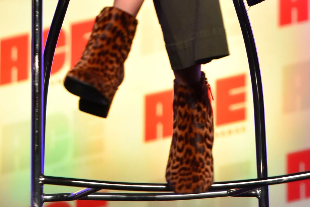 Brie Larson, leopard print booties, celebrity style, olive green pants, black and white jacket, headband, participates during a Q&A panel on day two at the Ace Comic-Con at the Donald E Stephens Convention Center, in Rosemont, Ill2019 Ace Comic-Con - Day 2, Rosemont, USA - 12 Oct 2019