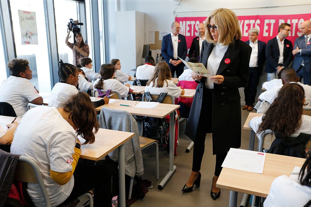 Brigitte macron, pointy-toed pumps, block heeled pumps, celebrity style, black jacket, skinny pants, white t shirt, MAXPPP OUTMandatory Credit: Photo by REGIS DUVIGNAU/POOL/EPA-EFE/Shutterstock (10443576c)Brigitte Macron, the wife of the French President, dictates to pupil at a school in Paris, France, 14 October 2019. A former teacher heself, Brigitte Macron returned to the classroom for a charity dictate in support of the European Leucodystrophie Association (ELA).Brigitte Macron, wife of French President, returns to classroom in Paris in support of ELA, France - 14 Oct 2019