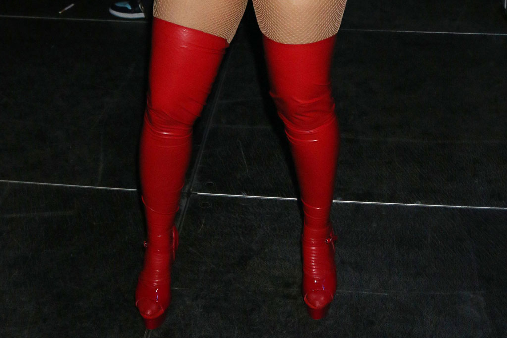 Cardi Bi, red boots, thigh-highs, fishnets, minidress, celebrity style, legs, cleavage, halloween 2019, rapper, Heart Radio Powerhouse at the Prudential Center, Newark, New Jersey, USA - 27 Oct 2019