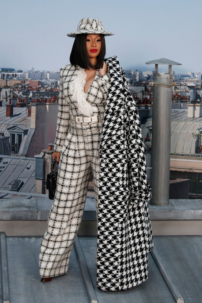 cardi b, chanel, celebrity style, front row, jumpsuit, platform shoes, houndstooth coat, hat, purse, Singer Cardi B poses for photographers as she arrives for the Chanel Ready To Wear Spring-Summer 2020 collection, unveiled during the fashion week, in ParisFashion S/S 2020 Chanel Arrival, Paris, France - 01 Oct 2019Wearing Chanel Same Outfit as catwalk model Cara Delevingne *10129489e and William Chan and Ayami Nakajo