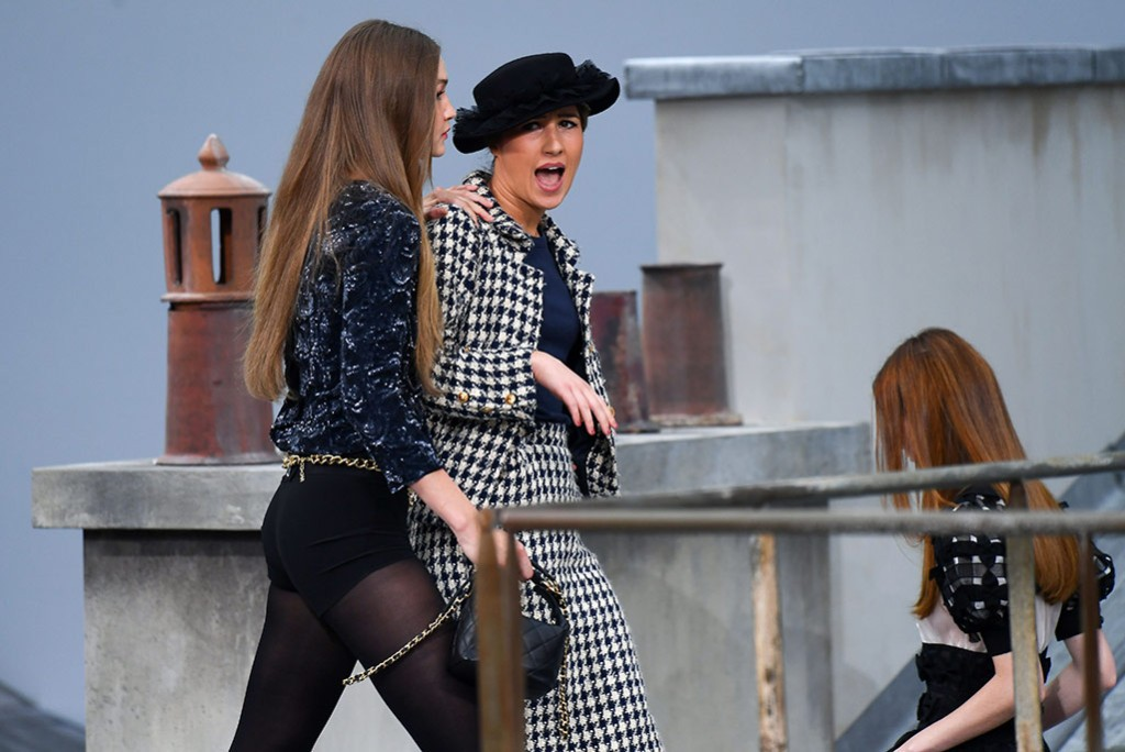 Gigi Hadid saves the Chanel show when French comedian crashes the spring 2020 runway.