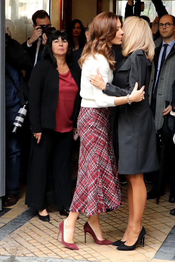 Brigitte macron, Louis Vuitton eyeline pumps, celebrity style, stilettos, classic black pumps, princess Mary, Alexander McQueen skirt, white blouse, Burgundy pumps, royal style, Paris