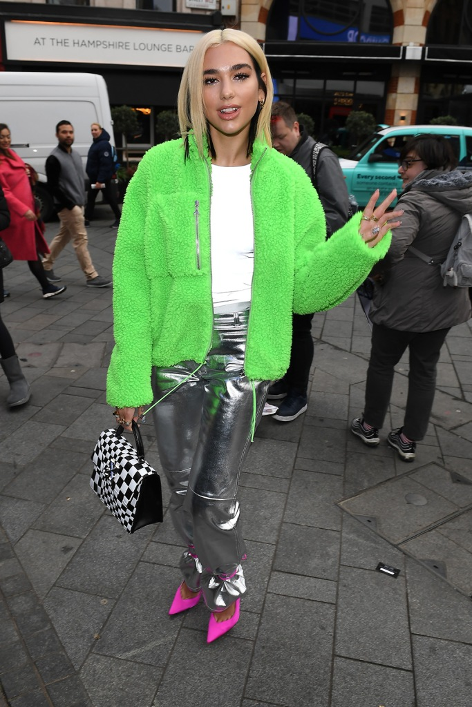 Dua Lipa, silver pants, the attico, pink pumps, satin pumps, stilettos, green fleece, white shirt, off-white purse, blonde, blond hair, celebrity style, at Global HouseDua Lipa out and about, London, UK - 29 Oct 2019