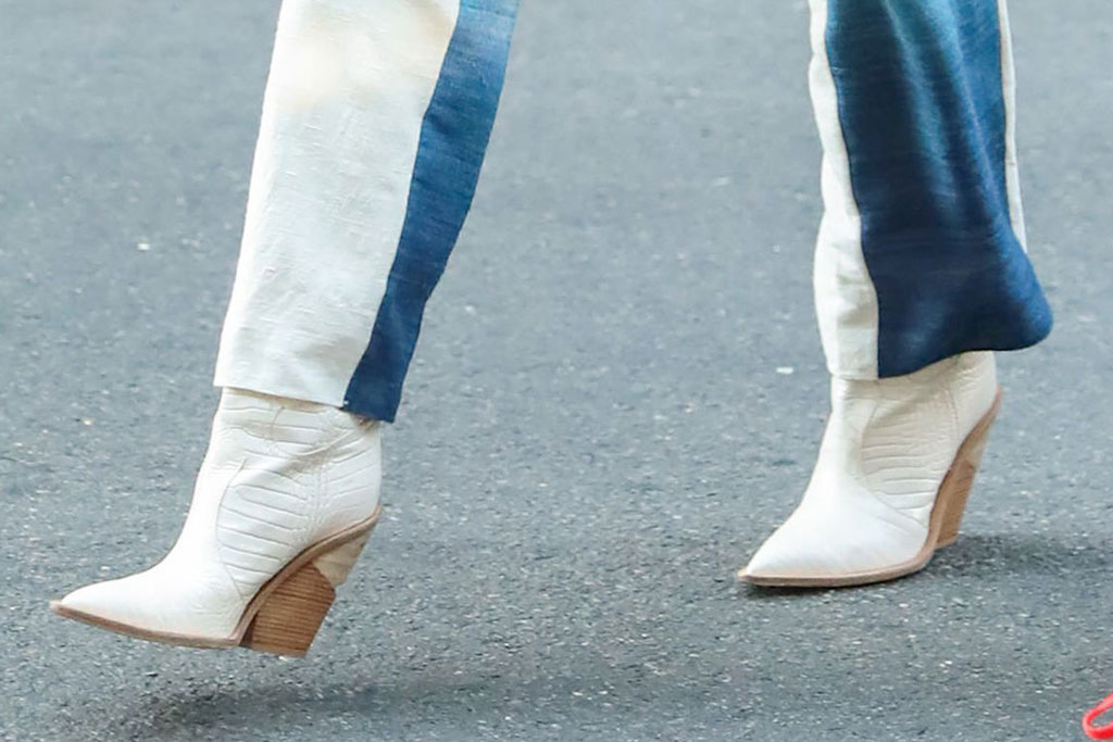 Gigi Hadid, celebrity style, new york city, ombre pantsuit, sunglasses, blonde hair, mini bag, western boots, fendi shoes, celebrity style