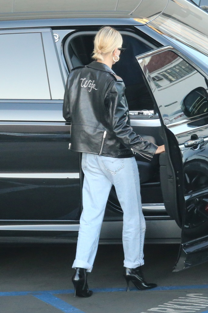 """Hailey Baldwin, Tabitha Simmons x Brock collection, booties, stilettos, celebrity style, leather jacket, wife jacket, jeans, Justin Bieber and and Hailey Bieber leave the movies after their wedding. They saw an afternoon showing of Abomidable at the iPic Theaters in the Westwood section of Los Angeles. She wore a leather jacket that said """"wife"""" as the pair had a low key movie date two days after their nuptials in North Carolina.Hailey Bieber:Jacket - Customised Celine Jeans - LevisBoots - Tabitha Simmons Hoops - Jennifer Fisher Bag - Chanel Sunglasses - CelinePictured: Ref: SPL5119976 031019 NON-EXCLUSIVEPicture by: SplashNews.comSplash News and PicturesLos Angeles: 310-821-2666New York: 212-619-2666London: +44 (0)20 7644 7656Berlin: +49 175 3764 166photodesk@splashnews.comWorld Rights"""