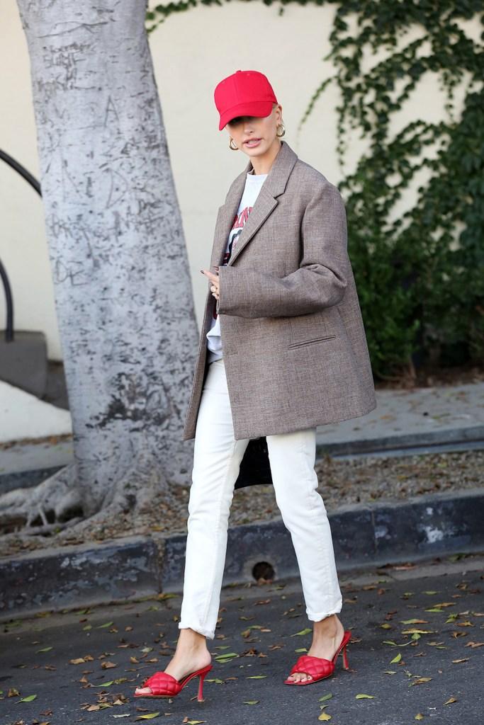 Hailey Baldwin, Hailey Bieber, red Bottega veneta sandals, white pants, jil sander blazer, celebrity style, street style, Cornell sweatshirt, Jennifer fisher gold hoop earrings, looking stylish sporting a red pair of heels and a matching hat. 09 Oct 2019 Pictured: Hailey Baldwin Bieber. Photo credit: Rachpoot/MEGA TheMegaAgency.com +1 888 505 6342 (Mega Agency TagID: MEGA523785_005.jpg) [Photo via Mega Agency]