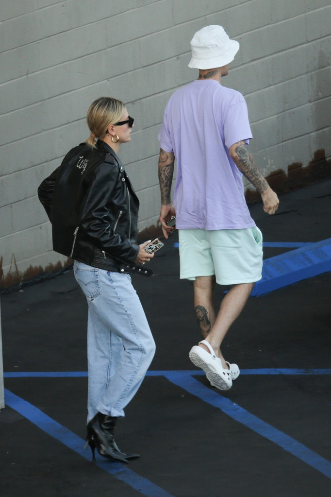 """Hailey Baldwin, Celine leather jacket, Levis jeans, Tabitha Simmons x Brock collection, stilettos, booties, celebrity style, Justin Bieber, crocs, rubber clogs, Justin Bieber and and Hailey Bieber leave the movies after their wedding. They saw an afternoon showing of Abomidable at the iPic Theaters in the Westwood section of Los Angeles. She wore a leather jacket that said """"wife"""" as the pair had a low key movie date two days after their nuptials in North Carolina.Hailey Bieber:Jacket - Customised Celine Jeans - LevisBoots - Tabitha Simmons Hoops - Jennifer Fisher Bag - Chanel Sunglasses - CelinePictured: Hailey Bieber,Justin BieberRef: SPL5119976 031019 NON-EXCLUSIVEPicture by: SplashNews.comSplash News and PicturesLos Angeles: 310-821-2666New York: 212-619-2666London: +44 (0)20 7644 7656Berlin: +49 175 3764 166photodesk@splashnews.comWorld Rights"""