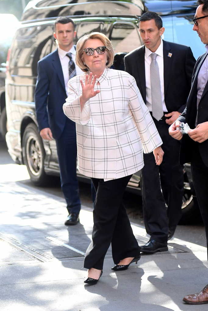 Hillary Clinton, white tunic top, black flare-legged pants, black kitten heels, low heeled pumps, shoe style, arrives at the ABC Studios this morning to make an appereance at The View in New York CityPictured: Hillary ClintonRef: SPL5119849 021019 NON-EXCLUSIVEPicture by: Elder Ordonez / SplashNews.comSplash News and PicturesLos Angeles: 310-821-2666New York: 212-619-2666London: +44 (0)20 7644 7656Berlin: +49 175 3764 166photodesk@splashnews.comWorld Rights, No Portugal Rights