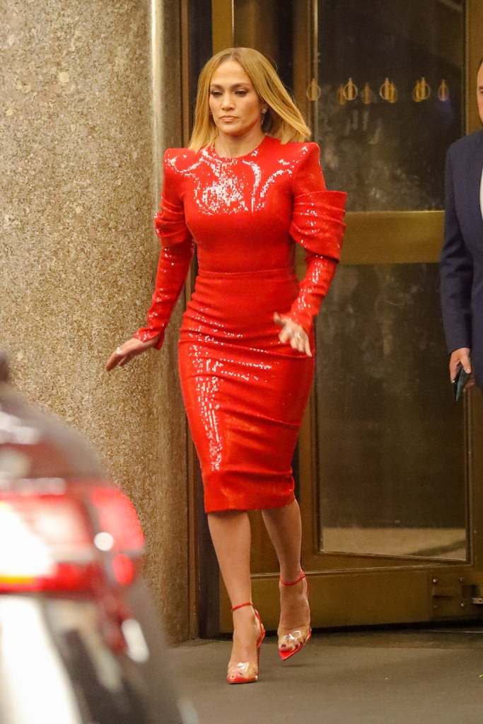 Jennifer Lopez, shiny red dress, pvc sandals, femme shoes, celebrity style, and John Bradley were spotted rushing to a car while leaving the NBC studios while filming the New Romantic Comedy 'Marry Me' in NYCPictured: Jennifer Lopez and John BradleyRef: SPL5120007 031019 NON-EXCLUSIVEPicture by: Felipe Ramales / SplashNews.comSplash News and PicturesLos Angeles: 310-821-2666New York: 212-619-2666London: +44 (0)20 7644 7656Berlin: +49 175 3764 166photodesk@splashnews.comWorld Rights