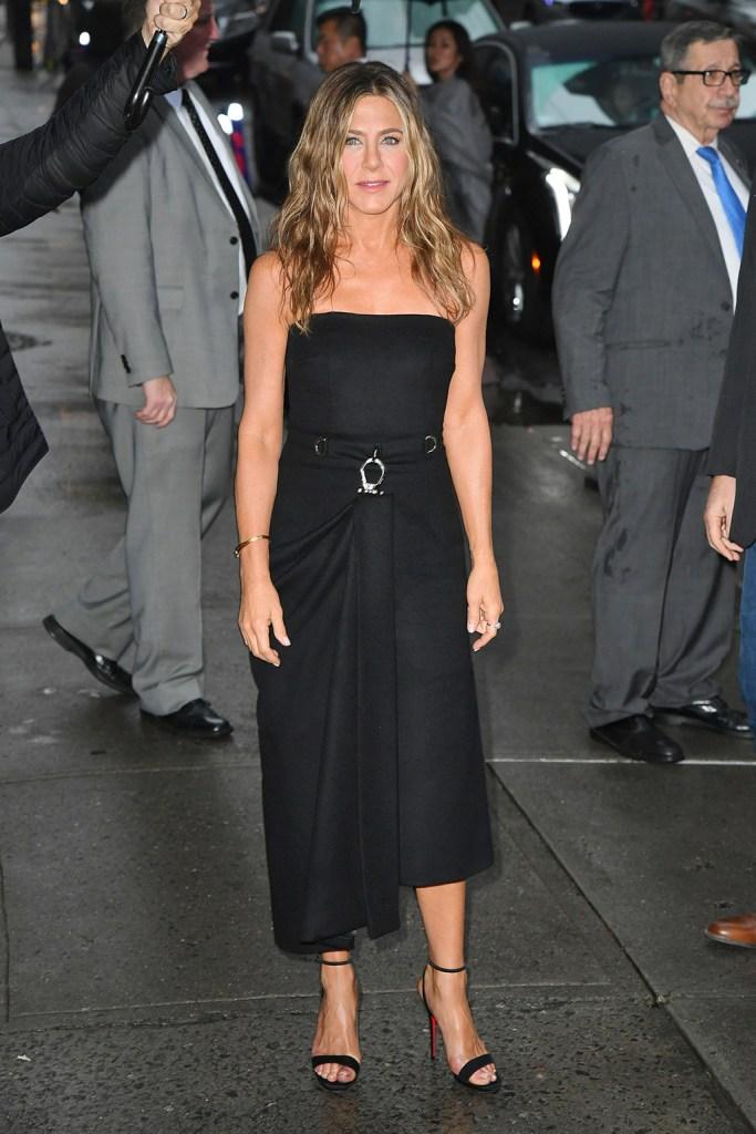 Jennifer Aniston, prada dress, black dress, midi dress, celebrity style, blonde hair, sandals, stilettos, christian louboutin sandals, stops by the Stephen Colbert show.Pictured: Jennifer AnistonRef: SPL5125163 291019 NON-EXCLUSIVEPicture by: SplashNews.comSplash News and PicturesLos Angeles: 310-821-2666New York: 212-619-2666London: +44 (0)20 7644 7656Berlin: +49 175 3764 166photodesk@splashnews.comWorld Rights