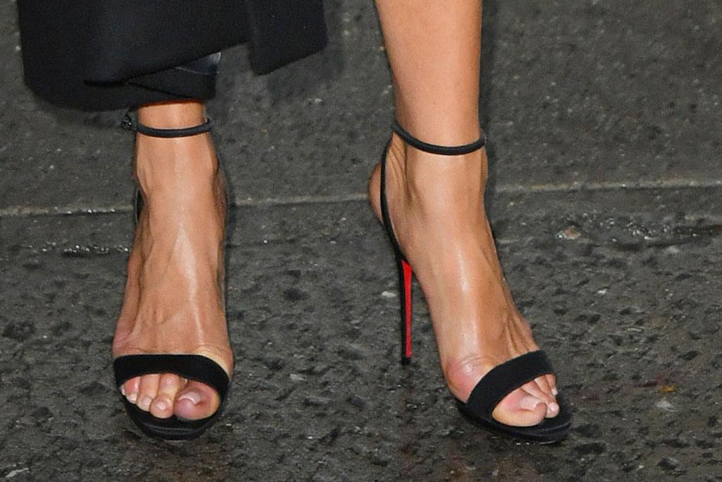 Jennifer Aniston, pedicure, stilettos, toes, feet , prada dress, black dress, midi dress, celebrity style, blonde hair, sandals, stilettos, christian louboutin sandals, stops by the Stephen Colbert show.Pictured: Jennifer AnistonRef: SPL5125163 291019 NON-EXCLUSIVEPicture by: SplashNews.comSplash News and PicturesLos Angeles: 310-821-2666New York: 212-619-2666London: +44 (0)20 7644 7656Berlin: +49 175 3764 166photodesk@splashnews.comWorld Rights