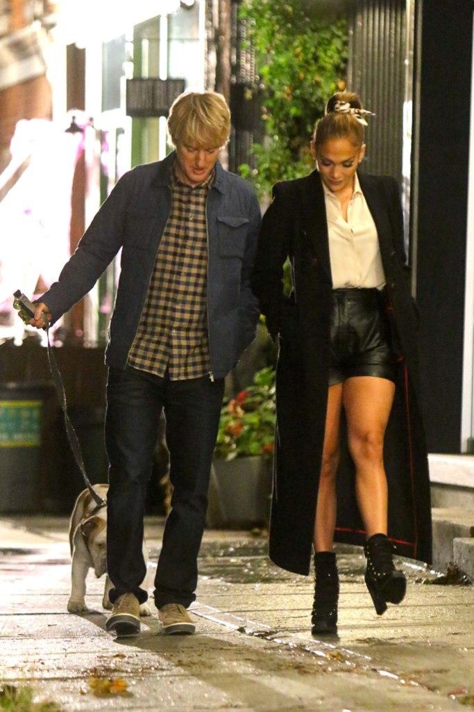 jennifer lopez, altuzzara, shorts, leather shorts, white blouse, long coat, legs, celebrity style, jimmy choo shoes, 5-inch boots, ankle boots, owen wilson, dog, puppy, marry me, romantic comedy, film set