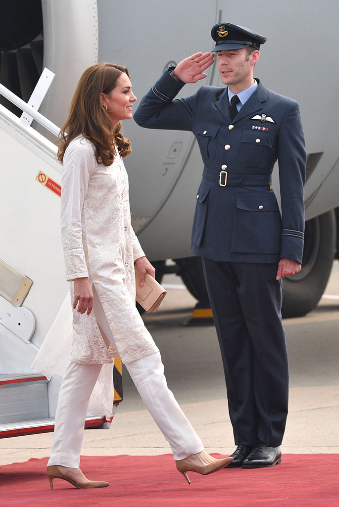 Kate Middleton arrives in Lahore Pakistan wearing a shalwar kameez by Gul Ahmed a shawl by Maheem Khan, pumps by J.Crew and carrying a bag by Mulberry England.
