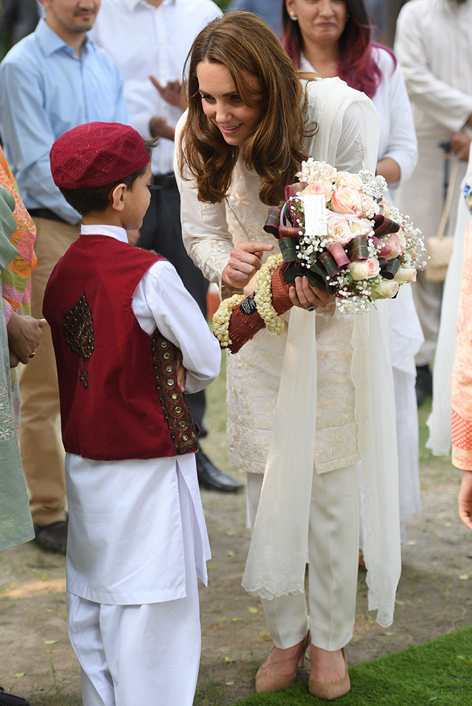 Kate Middleton at the SOS Children's Village, Lahore Pakistan wearing a shalwar kameez by Gul Ahmed a shawl by Maheem Khan, pumps by J.Crew and carrying a bag by Mulberry England.