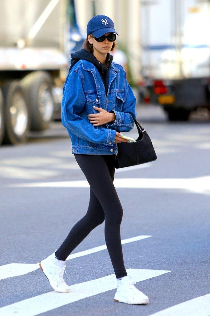 Kaia Gerber, street style, new york yankees hat, sunglasses, hoop earrings, hoodie, nyc, alexander wang x adidas, white sneakers, leggings, handbag,