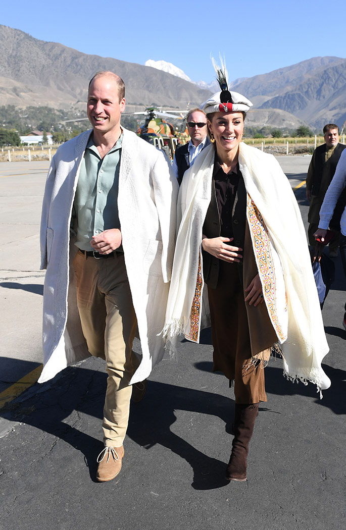 Kate Middleton and Prince William in the Himalayan foothills in Northern Pakistan. Kate is wearing a traditional Chitrali hat like the one Princess Diana wore for her own visit in 1991.