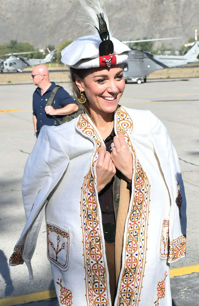 Kate Middleton in the Himalayan foothills in Northern Pakistan wearing a traditional Chitrali hat like the one Princess Diana wore for her own visit in 1991.