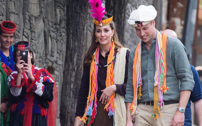 Kate Middleton wears a traditional Pakistani hat with a feather in spring '20 favorite shade of hot pink, Pakistan.