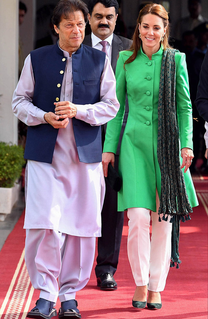 Imran Khan, Kate Middleton, Prince William. Kate Middleton wears pants by Maheen Khan, tunic by Catherine Walker, scarf by Satrangi and earrings by Zeen for a meeting with the Prime Minister in Islamabad.