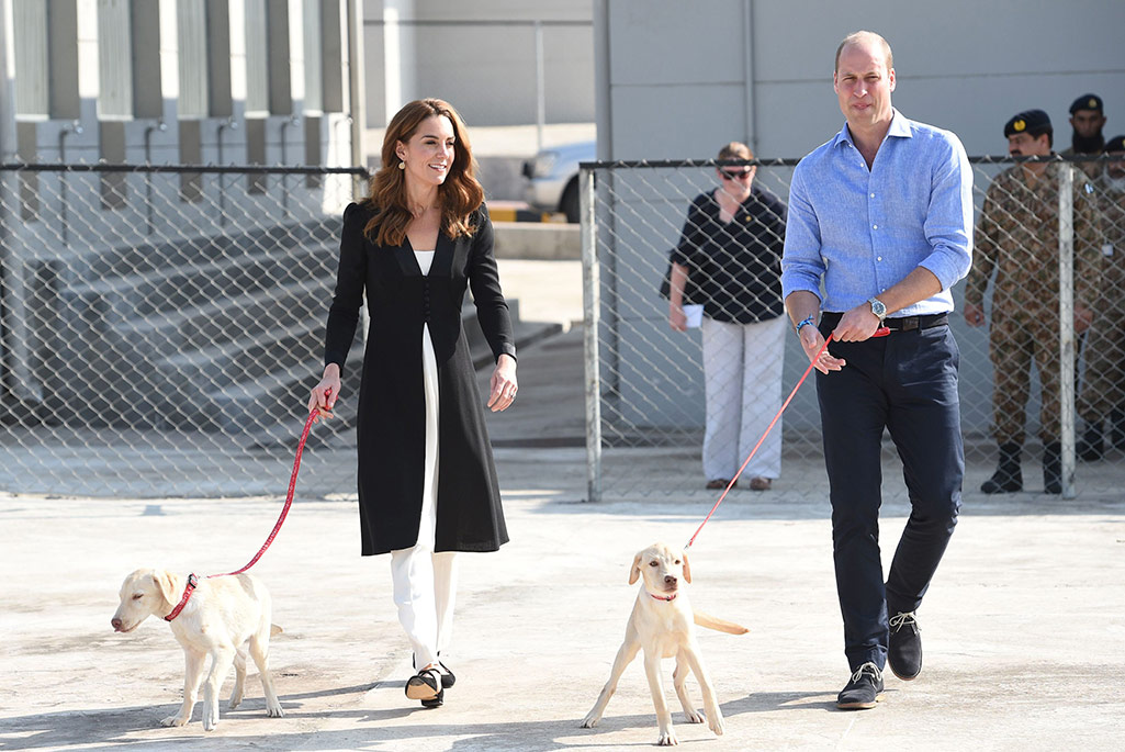 Kate Middleton wearing Russell & Bromley pumps and a coat by Beulah London for some puppy walking in Islamabad.