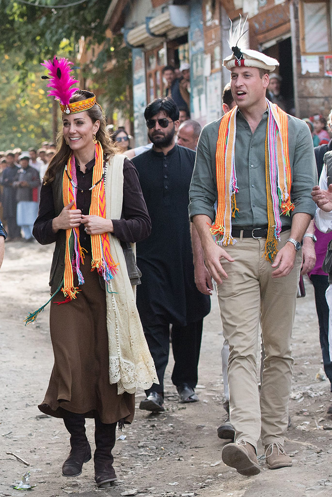Kate Middleton wears a traditional Pakistani hat with a feature in spring '20 favorite shade of hot pink, Pakistan.