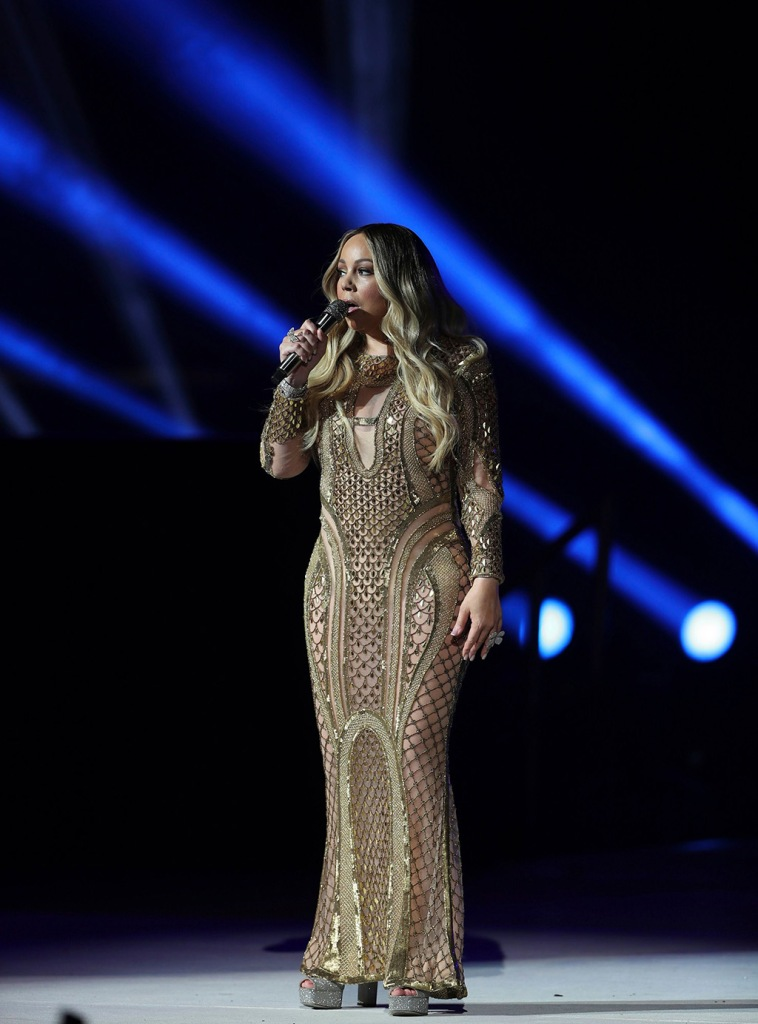 Mariah Carey, dubai, celebrity style, sheer dress, glittery dress, performance, silver platform sandals, amato couture, performs during a concert celebrating Dubai Expo 2020 One Year to Go in Dubai, United Arab EmiratesMariah Carey Expo 2020 One Year to Go, Dubai, United Arab Emirates - 20 Oct 2019Mariah Carey performs during a concert celebrating Dubai Expo 2020 One Year to Go in Dubai, United Arab EmiratesMariah Carey Expo 2020 One Year to Go, Dubai, United Arab Emirates - 20 Oct 2019