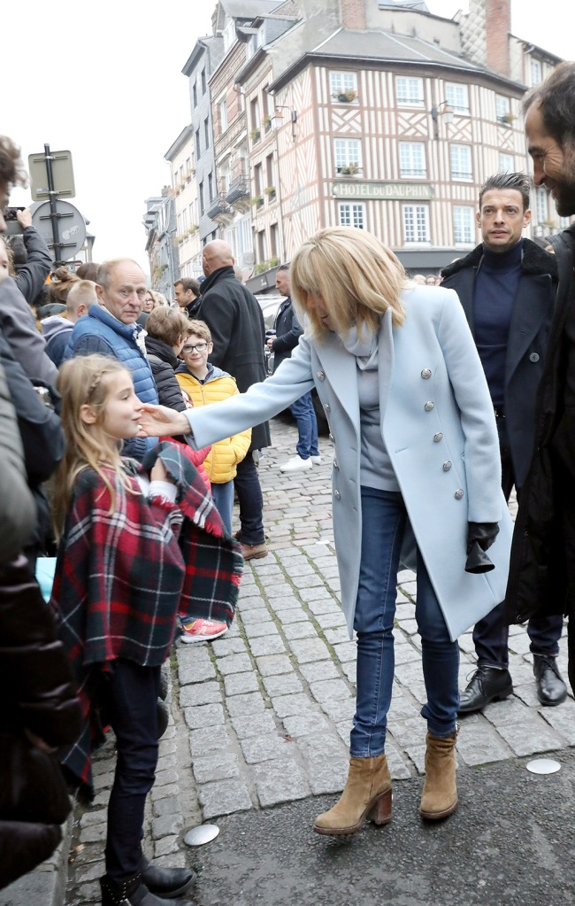 brigitte macron, tan booties, ankle boots, blue jacket, skinny jeans, france, first lady, French President Emmanuel Macron have a little rest in Honfleur in Normandy with his wife Brigitte. After a lunch at Bistro of Artists, they shaked hands and spoke with children about Halloween then they had a stroll on the typical harbor. October 31 2019. 31 Oct 2019 Pictured: Brigitte Macron. Photo credit: KCS Presse / MEGA TheMegaAgency.com +1 888 505 6342 (Mega Agency TagID: MEGA539243_010.jpg) [Photo via Mega Agency]