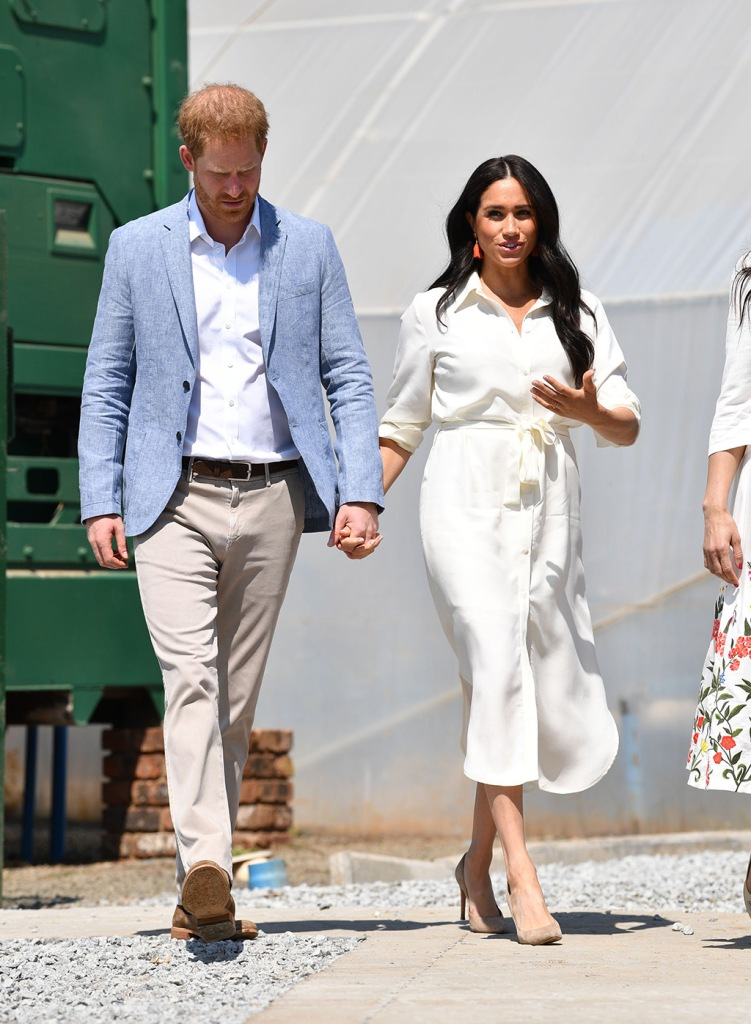 Meghan Markle, celebrity style, Johannesburg, South Africa, shirt dress, madewell earrings, Stuart weitzman shoes, nude pumps, stilettos, royal style, Britain's Prince Harry (R), the Duke of Sussex, and his wife Meghan (R), the Duchess of Sussex, visit the Tembisa township to learn about the 'Youth Employment Services' (YES), in Johannesburg, South Africa, 02 October 2019. The Duke and Duchess of Sussex are on an official visit to South Africa that concludes later the same day.Duke and Duchess of Sussex Royal tour of South Africa, Johannesburg - 02 Oct 2019Prince Harry and Meghan Duchess of Sussex at a township to learn about Youth Employment Services, JohannesburgPrince Harry and Meghan Duchess of Sussex visit to Africa - 02 Oct 2019