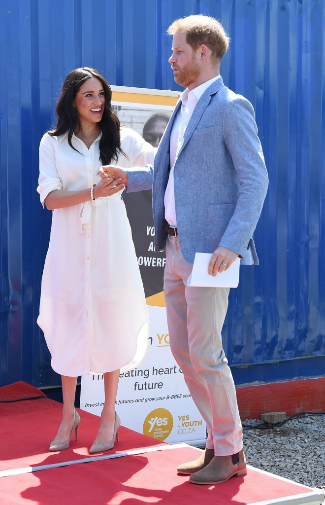 Meghan Markle, celebrity style, Johannesburg, South Africa, shirt dress, madewell earrings, Stuart weitzman shoes, nude pumps, stilettos, royal style, Britain's Prince Harry (R), the Duke of Sussex, and his wife Meghan (R), the Duchess of Sussex, visit the Tembisa township to learn about the 'Youth Employment Services' (YES), in Johannesburg, South Africa, 02 October 2019. The Duke and Duchess of Sussex are on an official visit to South Africa that concludes later the same day.Duke and Duchess of Sussex Royal tour of South Africa, Johannesburg - 02 Oct 2019
